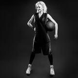 Black and white phoro of female basketballer. In studio Royalty Free Stock Photo