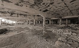 Abandoned industrial building. Wrecked interior. Black and white photo of an abandoned building. Empty, wrecked recked industrial interior royalty free stock photos