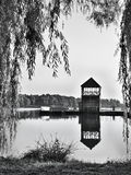 Black and white photo of Alum Lake 'Kamencove jezero' in Chomutov city. With wooden pier at the end of the summer tourist season Stock Photos