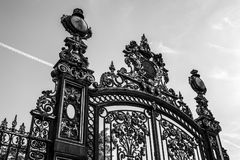 Black-white photo of ancient metal gate. Paris - France Stock Photo