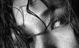 Black and white photo of Asian model with wet hair and drops of water on face Royalty Free Stock Photo