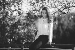 Black and white photo of attractive girl in park, bw stock photos