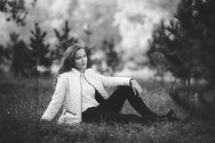 Black and white photo of attractive girl in park, bw royalty free stock images
