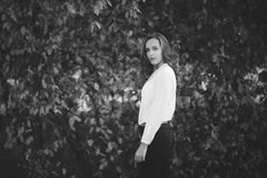 Black and white photo of attractive girl in park, bw royalty free stock image