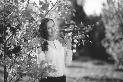 Black and white photo of attractive girl in park, bw stock image