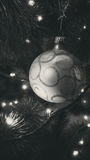 Black and white photo of bauble with ornaments on Christmas tree Royalty Free Stock Images