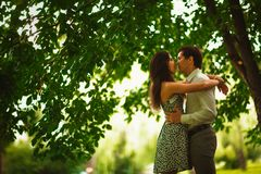 Black and white photo beautiful young couple in the park royalty free stock photo