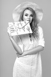 Black and white photo of a beautiful young woman in summer clothes in the studio Royalty Free Stock Images