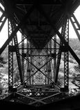 Black and white photo beneath the bridge at Deception Pass Washington Stock Images