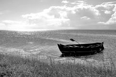Black and white photo of the boat on the shore. Baltic Sea, Pucka Bay, Poland Royalty Free Stock Photo