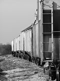 Black and white photo of boxcars on railroad tracks in a small, rural town in Tennessee. A black and white photo of boxcars on railroad tracks in small, rural Stock Photos