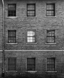 Black and white photo of brick facade with windows Royalty Free Stock Image