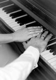 Black and white photo of bride and groom playing on piano Royalty Free Stock Images