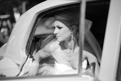 Black and white photo of a Bride waiting in the car Royalty Free Stock Photos