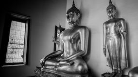 Black and white photo .Buddha gold statue and thai art architecture Royalty Free Stock Image