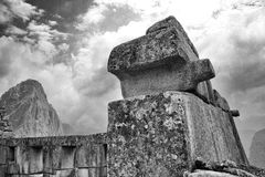Black & White photo of buildings in Machu Picchu. A view upwards through the Machu Picchu buildings Stock Photos