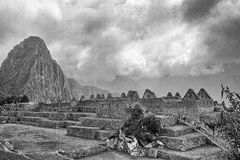 Black & White photo of buildings in Machu Picchu. A view upwards through the Machu Picchu buildings Royalty Free Stock Photo