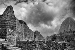 Black & White photo of buildings in Machu Picchu. A view upwards through the Machu Picchu buildings Stock Image