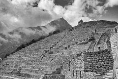 Black & White photo of buildings in Machu Picchu. A view upwards through the Machu Picchu buildings Stock Photography