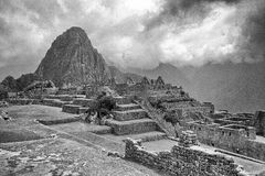 Black & White photo of buildings in Machu Picchu. A view upwards through the Machu Picchu buildings Royalty Free Stock Photography