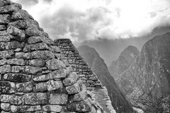 Black & White photo of buildings in Machu Picchu. A view upwards through the Machu Picchu buildings Royalty Free Stock Photos