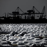 Black and white photo of cars parked at the port. Of Koper Stock Photos