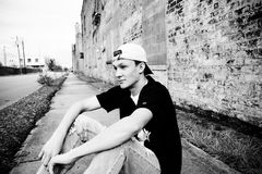 Black and White American Teenage Boy In Baseball Hat stock photos