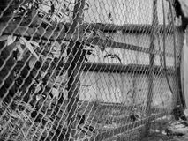 BLACK AND WHITE PHOTO OF CHAIN-LINK FENCE Stock Images