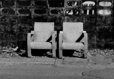 Black and white photo of white chairs. royalty free stock images