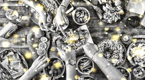 Black and white photo. Christmas dinner. Falling golden snowflakes. black and white image. Top of view of a nicely served table. T. Christmas dinner. Falling Royalty Free Stock Images