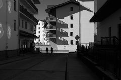 Black and white photo of city street with long shadows. Black and white photo of city street with long shadows Stock Photo