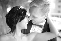 Black-and-white photo.closeup. portrait of happy groom and beautiful bride. In retro style Stock Photo