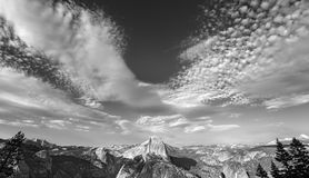 Black and white photo of cloudscape over Half Dome in Yosemite N Royalty Free Stock Photos
