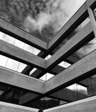 Black-and-white photo of a glass and concrete contemporary building Royalty Free Stock Photo