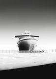 Black and white photo of a cruise ship at port royalty free stock photos