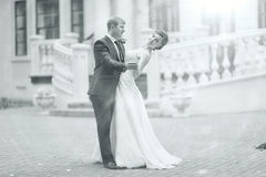 Black and white photo dancing bride and groom Stock Photography
