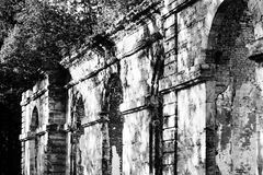 Black and white photo dilapidated building forestry greenhouse in the palace park buildings date 18th century, Gatchina, Russia. Royalty Free Stock Photos