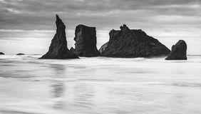 Black and white photo Dramatic ocean scene in Bandon Oregon. Dramatic sea stacks in Bandon Oregon ocean panorama no people banner wallpaper landscape Royalty Free Stock Image