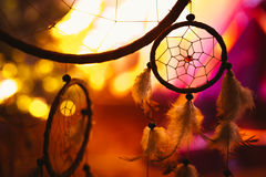 Black and white photo of a dream catcher at sunset purple dark background.  Royalty Free Stock Photography