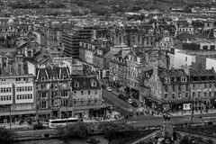 Black and white photo of Edinburgh downtown, Scotland. Gothic scottish capital city center in black and white. Edinburgh main street in Scotland. Residential Royalty Free Stock Images