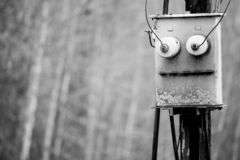 The black and white photo of the electric box similar to face of the old robot. The black and white photo of the electric box similar to face of the robot royalty free stock images