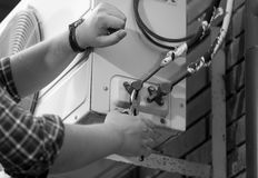Black and white photo of electrician repairing air conditioning Royalty Free Stock Images