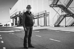Black and white photo of engineer standing on building site Royalty Free Stock Images