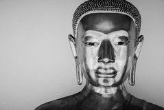 Black and white photo .Face of Buddhastatue and thai art architecture Royalty Free Stock Photo