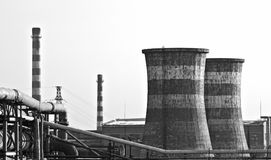 Black & White photo of factory with giant chimneys Stock Image