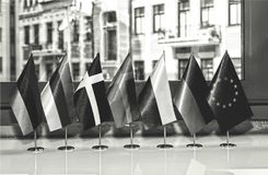 European Union, flag Europe a country European National sym. Black and white photo. Flags of European countries and the flag of the European Union close up at Royalty Free Stock Images