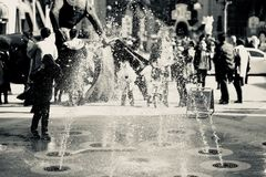 Black and White Photo of Fountain and People Stock Photography