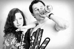 Black and white photo girl and the guy with a bottle Stock Images