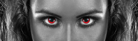 Black and white photo of girl with red eyes Stock Photography