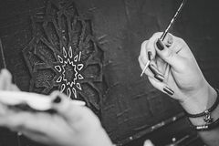 Black and White Photo of Hands Holding a Paintbrush Royalty Free Stock Image